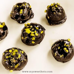 Chocolate covered low-carb keto pistachio marzipan bites are a boutique case of a keto dessert. They're easy to make, but make you feel special with every bite. #keto #ketogenic #ketodiet #lowcarb #ketodessert #marzipan #pistachio #lowcarbmarzipan